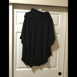 Black capelet with ruffle edge and turtle neck